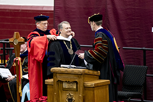 Dr. Gard, president of CUC, awards Dr. Rast with an honorary doctorate.