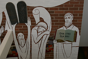 The library mural shows how the Word of God has been passed on from generation to generation.