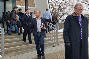 Students and faculty exit Kramer Chapel after Ash Wednesday service.