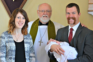 Pastor Dahlke with Chris and Adriane Heins with daughter, Georgia