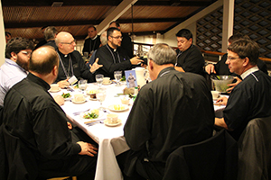Pastors gather in the dining hall to eat and fellowship.