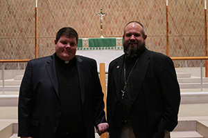 Alexander Sobel stands next to English District President, Rev. Hardy.