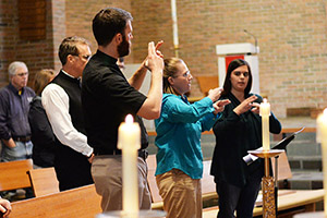 Signers interpreting during service at the University of Chicago chapel.