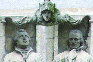 Three statues: Athena, representing wisdom and learning, flanked by Martin Luther and Philip Melanchthon.