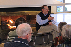 President Rast speaks with a group over a fireside chat.