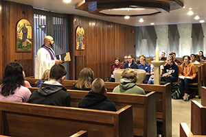 Rev. Matthew Wietfeld, Director of Christ Academy, leads worship service at a Confirmation Retreat last spring.