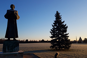 Luther statue stands in the foreground of the CTSFW campus; Kramer Chapel is just visible far behind it.