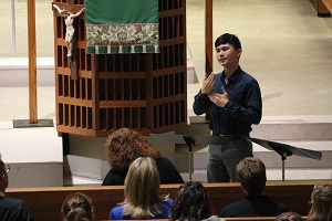A CITI participant practices his ASL by interpreting the sermon during chapel.