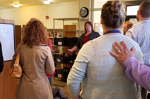 Co-op Director Katherine Rittner leads a tour for last year's fall PCV.