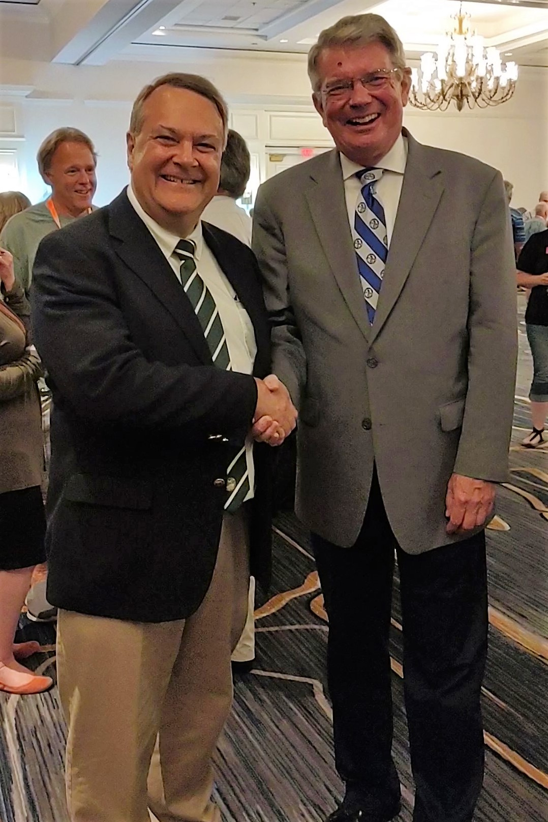 Dr. Rast (left) and Dr. Meyer (right) shake hands at the joint seminary alumni reception at the 2019 Synod Convention in Tampa, FL.